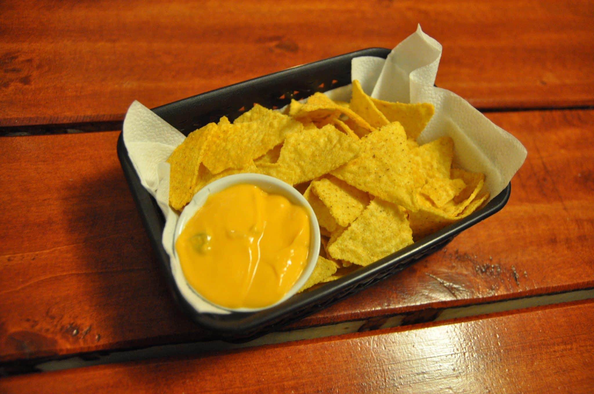 spicy tortilla chips, cheese sauce